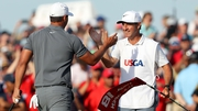Ricky Elliott (R) celebrates with Brooks Koepka