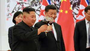 North Korean leader Kim Jong-un and Chinese President Xi Jinping make a toast at the Great Hall of the People in Beijing