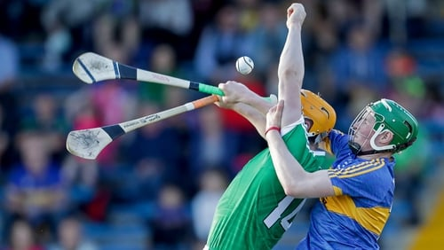 Limerick's Seamus Flanagan and Brian McGrath of Tipperary compete for the ball