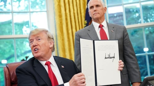 Donald Trump signs his latest executive order at the White House
