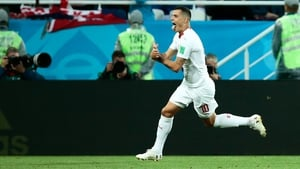 Granit Xhaka celebrates his goal against Serbia by making a gesture with his hands that was an apparent nod to the Albanian flag.