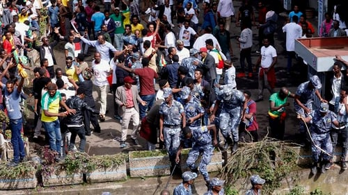 Ethiopian security forces intervene after the blast went off at the rally in Meskel Square