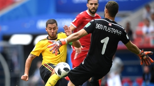Eden Hazard rounds the Tunisian keeper Ben Mustapha to score his second and Belgium's fourth
