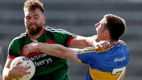 Aidan O'Shea holds off Tipperary's Jimmy Feehan