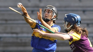 Laura Loughnane of Tipperary battles Aine Lacey for possession