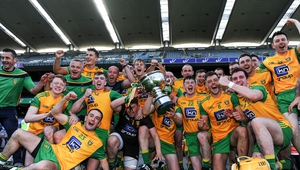 The Donegal team celebrate with the Nicky Rickard Cup