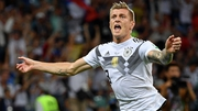 Toni Kroos celebrates his late, late winner to keep his side in with a real chance of progressing to the knock-out stages