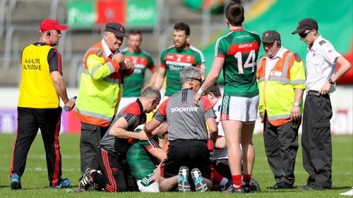 Seamus O'Shea is treated on the pitch