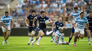 Adam Hastings runs with the ball for Scotland