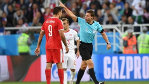 Referee Felix Brych gestures to Aleksandar Mitrovic during Serbia's 2-1 defeat to Switzerland