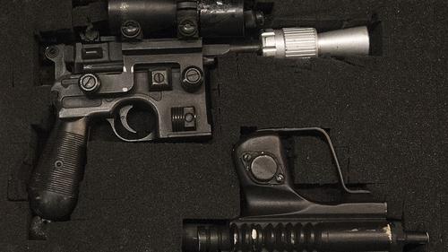 Han Solo's BlasTech DL-44 blaster and a Star Wars biker scout blaster