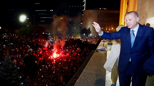 Recep Tayyip Erdogan greets the crowd from the balcony of the ruling AK Party's headquarters following his election win