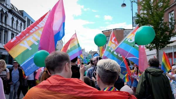 Crowds gather at a Gay Pride parade in Belfast