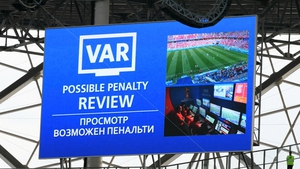 The big screen inside the stadium displays a VAR penalty review during the game between Saudia Arabia and Egypt
