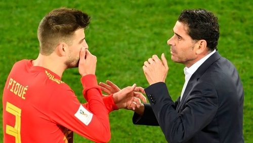 Spain's defender Gerard Pique (L) chats with Spain's coach Fernando Hierro