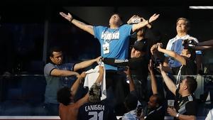 Diego Maradona celebrates Lionel Messi's opener