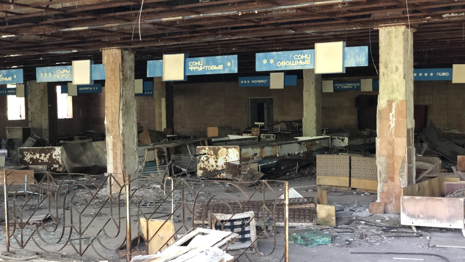 Image - The checkouts, shelves and trolleys still visible in the abandoned supermarket of Pripyat