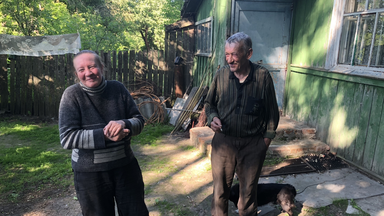 Image - Sveta Shelkunova and Peter Belyakov outside their home in what remains of Bartholomevka village