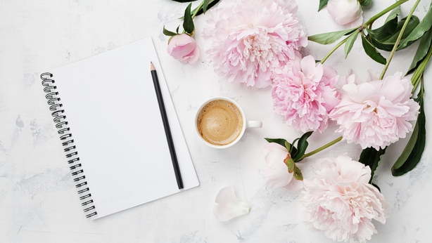 empty notebook, pencil and pink peony flowers