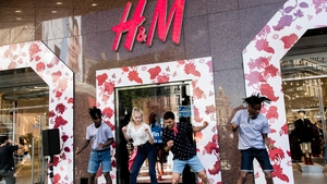 H&M said sales before currency fluctuations were up 8% in the three months from June to August from a year earlier.