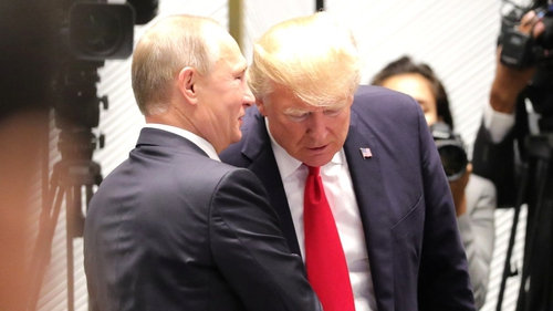 Vladimir Putin and Donald Trump speak at the 25th APEC Summit in Vietnam in November 2017