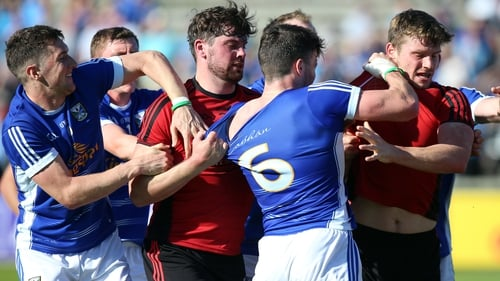 Cavan and Down players clash at the end of the fiery qualifier