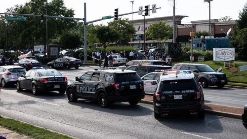 Police take measures after multiple people were fatally shot and wounded when a gunman opened fire at the Capital Gazette newsroom