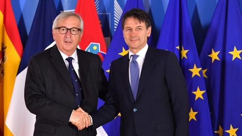 European Commission President Jean-Claude Juncker (L) with Italian PM Giuseppe Conte during the EU summit