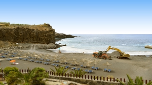 A bulldozer carrying out beach repair on the Canary Islands. Photo: Peter Etchells/iStock