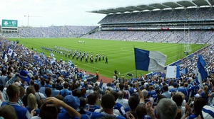 Dublin and Laois walk on to the Croke Park pitch for the 2005 Leinster SFC final