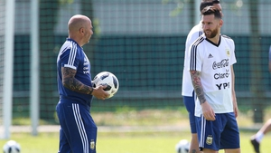 Jorge Sampaoli (L) and Lionel Messi at training on Friday