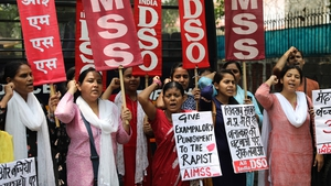 Activists hold placards as they protest against the rape in Mandsaur, India