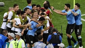 Edinson Cavani's brace has sent Uruguay through to the World Cup quarter-finals.