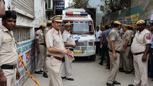 Police and an ambulance attend the scene at the house in New Delhi