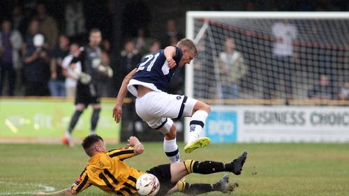 Kris Twardek (navy) in action for Millwall