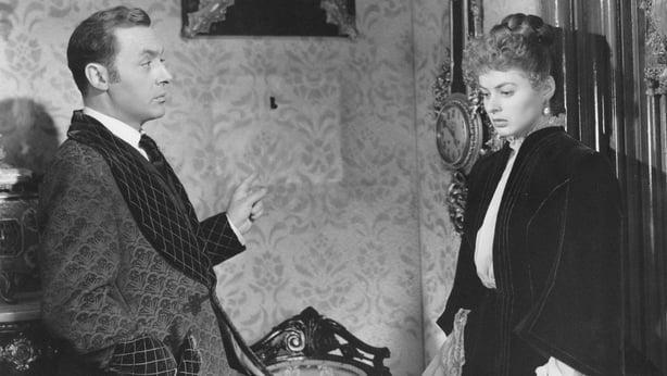 French-born American actor Charles Boyer talking to Swedish actress Ingrid Bergman in the film Gaslight. 1944