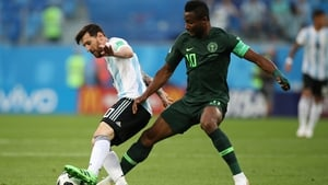 John Obi Mikel attempts to dispossess Leo Messi during the World Cup group game against Argentina