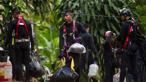 Rescuers are examining how to get the boys out through several kilometres of flooded tunnels