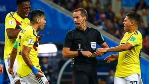 Colombia's Yerry Mina, Radamel Falcao and Juan Fernando Quintero (L-R) harangue referee Mark Geiger