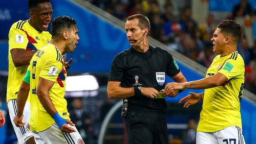 Colombia's Yerry Mina, Radamel Falcao and Juan Fernando Quintero (L-R) harangue referee Mark Geiger