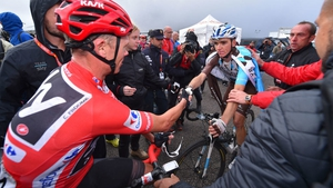 Chris Froome (L) and Romain Bardet shake hands during last year's Vuelta