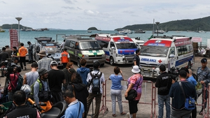 Ambulances wait at Chalong Pier on Phuket island