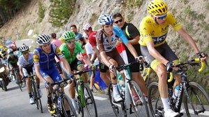 Dan Martin (L, blue jersey) will have Chris Froome in his sights