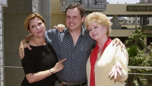 Todd Fisher (centre), with his sister Carrie (left) and their mother Debbie Reynolds.