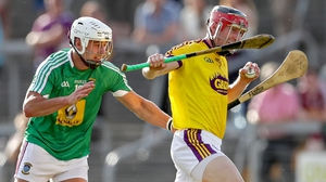 Wexford's Diarmuid O'Keefe battles with Robbie Greville of Westmeath