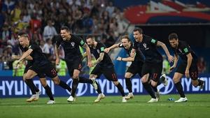 Croatia's players celebrate winning the penalty shootout