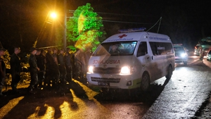 An ambulance leaves the Tham Luang cave area after divers evacuated some of the boys