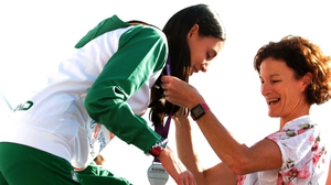 Sonia O'Sullivan presents daughter Sophie with her medal