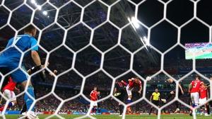 Domagoj Vida of Croatia scores his team's second goal v Russia