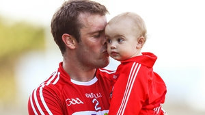 Cork's James Loughrey with his daughter Aoibhe after the game